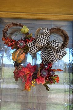 My first fall Disney wreath, even added a hidden Mickey...I wish I was talented enough to make something like this...crafty I am not...