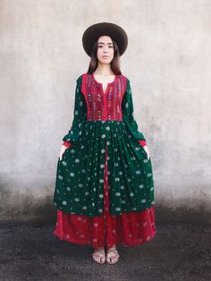 Vintage 60s/70s Afghan dress. Beautiful cross stitch detailing along bodice with hints of red velvet. Hunter green and red floral patchwork cotton. Two layered skirt. Red velvet back and cuffs. Snap button closure at cuffs. Zips up right side. Satin lining along back and cuffs. ***Due to a
