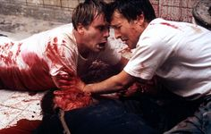 """SAW (2004)  Dr Lawrence Gordon: """"He doesn't want us to cut through our chains. He wants us to cut through our feet!""""   James Wan put such nourishing TV offerings behind him to write and direct this fiendishly contrived horror yarn. Two men wake up chained to the wall of a subterranean bathroom to be told that one must kill the other in order to survive. Their judge and jury is the mysterious Jigsaw - a calculating sadist dreaming up ever more elaborate methods for his victims to die."""