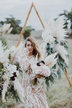 Little Love Story Triangle wedding arch / Peggy Saas Wedding Photographer / Rue De Seine Avril Gown for the Boho Bride / The Pretty Parlour bridal hair & makeup / Botanica Naturalis pampas bouquet