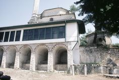 Aslan Pasha Mosque in Ioannina, Greece | http://archnet.org/sites/9159 Southern elevation, showing closed portico over stone vaults for ablution; eight-sided mausoleum believed to belong to Aslan Pasha at right. Photo by Stephania Zographaki