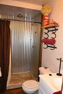 Corrugated metal shower. Love the towel rack too.