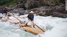 On this Japanese river, riders rush down rapids on narrow wooden rafts -- while standing up