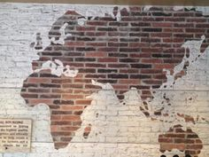 Twitter / lancewallnau: This coffee shop takes a brick wall and does something simple and brilliant with white paint. I could do that.