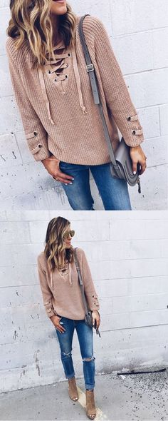Long sleeve with strap detail, lace-up with self-tying strap, knit sweater tunic. 55% Cotton 45% Acrylic, Imported. 27'in long ( Size Small)