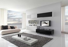 Interior: Modern Interior Design Ideas With Foamy Sofa Faced Low Profile Coffee Table Above Grey Fur Rugs In Addition To Moveable Vabinet Beneath Wall Mounted LED TV And Floating Bookcase: interior design ideas 2014
