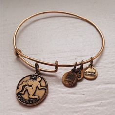 Alex and Ani Aquarius Bangle In excellent condition and has never been worn. Does NOT come with originally packaging. Extremely cute. Bundle to save  Alex & Ani Jewelry Bracelets