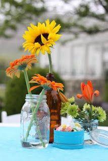 Root beer/glass soda bottles as vases.