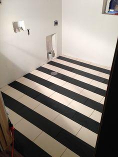 Striped tile floor in laundry - so cute. design dump: construction progress: week 21 + 22