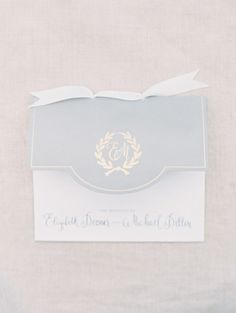 Elegant gray, white and gold wedding invitations: http://www.stylemepretty.com/2014/05/01/oh-so-classic-nautical-wedding/ | Photography: Erich McVey - http://www.erichmcvey.com/