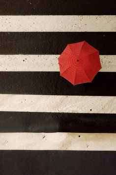from TheFullerView red umbrella black and white stripes parapluie rouge