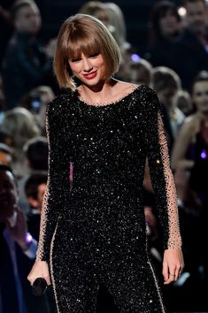 Taylor performing Out of the Woods at the 58th Annual Grammy Music Awards 2.15.16