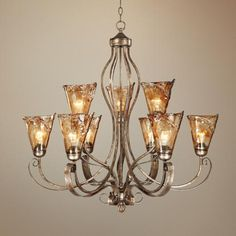 Instead of a plain ceiling light, how stunning would an art glass chandelier be in a traditional great room?