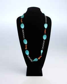 Vi Bella Jewelry - Yuma Necklace - Southwest style is making a comeback this year! The Yuma Necklace is made up of large crackled turquoise beads, copper disc beads, and small flat orange beads on a large-link silver chain. Wear with the Flagstaff Necklace and Earrings     Length:  34 Inches     Handcrafted by Vi Bella Artists in Haiti  $42.95