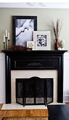 This could work with pictures of nature, and really, large, heavy candlesticks and pillar candles (our mantle is so much larger, and the fireplace is large stones.