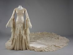 Wedding Dress Circa 1933 Worn by Margaret Whigham, later the Duchess of Argyll, for her marriage to Mr Charles Sweeny in the Brompton Oratory, 21 February 1933. The dress took a team of 30 seamstresses six weeks to make, and the bride thought it shockingly expensive at £52.
