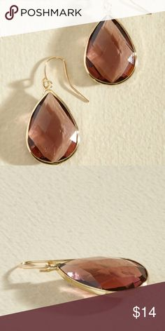 Drop Earrings in Plum Plum colored diamond shaped drop earrings wrapped in gold accents. Dress up any outfit! Jewelry