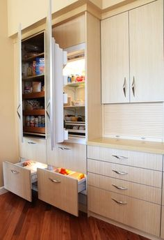 Custom Pantry, Sub-Zero Refrigerator, Sub Zero Crisper Drawers & Sub-Zero Freezer Drawers all Tucked Away behind Cabinet Door