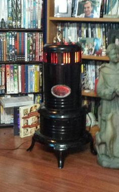 """Kerosene Heater.  Add """"Fire & Ice"""" Halloween Lights from Wal Mart and it looks like real fire going.  Everyone is shocked that there is no odor of Kerosene, then they find out it is also cold."""