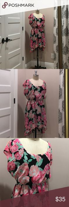 Candies Floral Summer Dress This dress is really as pretty as it photographs! Beautiful florals and colors mixed with flowy materials. This is exactly what you think of, when you need a summer dress! Size XL. Worn once and in great condition. ✅Pet And Smoke Free Home ✅Accepts Reasonable Offers ✅Same Business-Day Shipping ✅Bundle and Save Candie's Dresses Midi