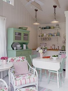 cottage or cabin kitchen. Love the use of painted furniture and the efficiencies of a small room!