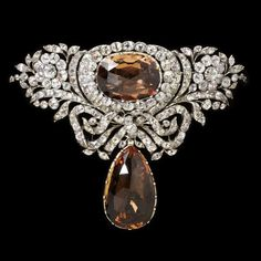 """Topaz is the star this month so might as well start out with a spectacular example! This bodice ornament feature two large golden or """"sherry"""" colored topaz stones that are surrounded by white topaz and rock crystal quartz. It was created in Portugal around 1770. Currently it is part of the Victoria & Albert museum collection. ."""