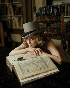 Gotta like a woman in a top hat.