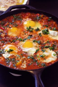 Shakshuka - hot tomato sauce with eggs. Looks like a delicious breakfast.