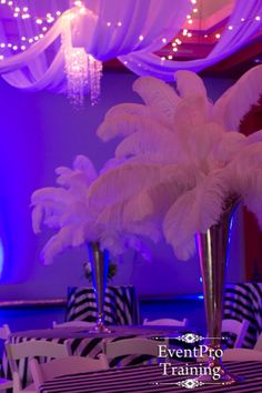 Paris Prom Theme Centerpiece and black and white stripe linens the ceiling draping and chandeliers are perfect From Event Pro Training