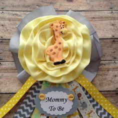 Giraffe Theme Mommy To Be Baby Shower Giraffe Theme Mommy To Be Corsage  Yellow & Grey Chevron Mommy To Be Corsage  Measure 4 wide x 7 long  Ready for shipping via USPS First Class Standard Rates Fees  For Rush Order Send You Request Via Convo.  IMPORTANT: PLEASE STATE DATE NEED BY AND THE NAME ON TAG Baby Shower Giraffe, Baby Shower Yellow, Baby Shower Fun, Baby Shower Gender Reveal, Elephant Theme, Grey Chevron, Corsage, Baby Ideas, Shower Ideas