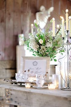 Taller arrangements and mixed candlelight add texture to the table settings