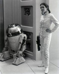Behind the scenes...Carrie Fisher as Princess Leia with R2-D2 in EPISODE V - THE…