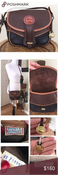 """VINTAGE DOONEY AND BOURKE SM TETON SHOULDER BAG Excellent condition!! D&B Small Teton Shoulder Bag in the colors Brown, Black & Saddle Tan Trim.  There is no scratches or scuffs.  The piping shows little to no wear.  Minor surface scratches and tarnish to the hardware. Clean interior and exterior.  The is slight peeling by the D rings but I believe that is due to age not wear.(SEE ALL PICS) ALL MEASUREMENTS ARE APPROXIMATE: 7.5"""" W X 7.0"""" H X 3.0"""" D 19.0""""-21.0"""" Adj strap.  1 interior zip…"""
