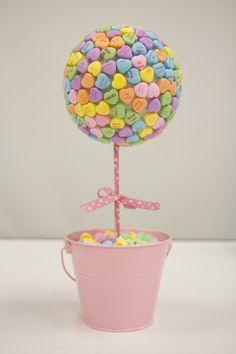 Valentine's Craft! Supplies: 2 bags of conversation hearts, wooden dowel, ribbon, styrofoam ball, base, and glue gun. #TheChew