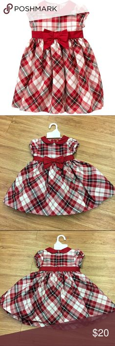 Gymboree Holiday Memories Red Plaid Duppioni Dress Gymboree Holiday Memories Red Plaid Duppioni Dress 6-12 Mo  She'll be a vision of holiday delight in festive plaid. Ideal for family photos and special events, our elegant duppioni dress with hints of metallic thread features a sweet peter-pan collar and full shirred skirt for extra twirl. Finished with a pretty sash and front bow. Nylon lining with tulle underlayer creates a flouncy shape.  Details * 100% polyester duppioni * Invisible back…