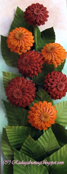 Quilled flowers. I'd like it better with quilled leaves also, but these are still pretty cool-looking.