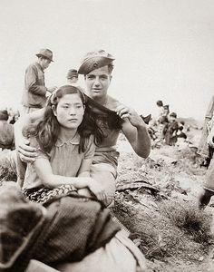 American soldiers forces himself on an unwilling Japanese girl
