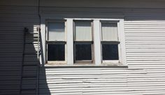 Here are the windows after the painted glass panes were replaced and re-glazed.