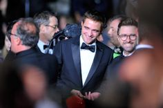"""Robert Pattinson Actor Robert Pattinson (L) and director David Michod attend """"The Rover"""" premiere during the 67th Annual Cannes Film Festival on May 18, 2014 in Cannes, France"""