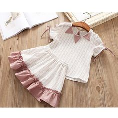 Stylish 2 piece set - printed top with tie detail on sleeves and ruffled skirt. Please allow weeks for shipping Baby Girl Party Dresses, Dresses Kids Girl, Kids Outfits Girls, Toddler Girl Outfits, Baby Girl Fashion, Toddler Fashion, Kids Fashion, Fashion Bags, Baby Girl Dress Patterns