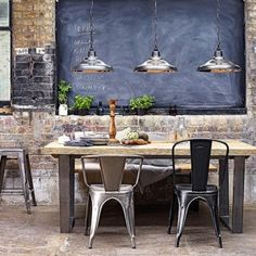 Calia eight seater dining table pictured with industrial style metal Tolix chairs and Davey school lighting, all John Lewis