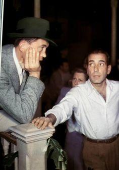 A rare colour shot of great friends Humphrey Bogart and John Huston on the set of Key Largo.