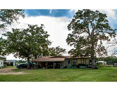 8160 COUNTY ROAD 150 Horse Lover's Paradise! Come home to tranquil country living on 18.96 acres. Your horses will enjoy the low maintenance open-air show barn with 12 stalls, electricity, wash rack, tack area, and even an office for you! The smaller of the two barns offers 4 additional stalls and tack area. Each stall is designed for flexible expansion to add outside runs when needed. 6 of the total 16 stalls are stallion stalls.