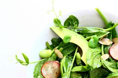 Pea Shoot Salad with Fava Beans | By: Theyearinfood | Pea shoots are the perfect starting point for a salad that absolutely celebrates spring. Fava beans, radishes, avocado and almonds give depth, texture and contrast to this bright salad.  | From: food52.com