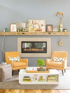 Modern fireplace paired with modern yellow and grey accents and rustic touches, comfortable and delightful!