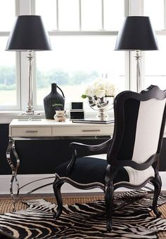 The black-and-white design of this sitting area is simply gorgeous. - Traditional Home ® / Design: Joy Tribout