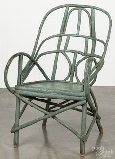 Painted Adirondack armchair retaining an old blue/green surface.