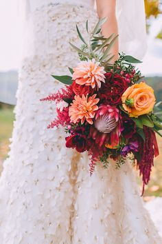 autumn wedding bouquet, photo by Nicole Baas Photography http://ruffledblog.com/seasonal-autumn-wedding-in-new-england #dahlia #weddingbouquet #bouquets