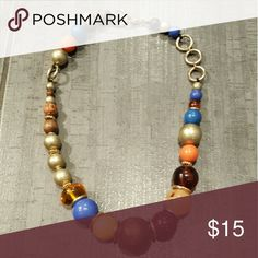 "Beaded Statement Necklace Statement necklace in bold colorful beads. Mixed media look includes wood beads, gold tone metal, and other various beads in shades of orange, blue, and yellow.   Approx length: 20""  Very good pre-owned condition.  For size reference: Largest center wooden bead measures 1"" across and 1"" high.  Quality fashion jewelry brand from Nordstrom called Sequin. Jewelry Necklaces"