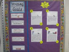"""My writing bulletin board has both writing goals and  """"rate your work"""" examples."""